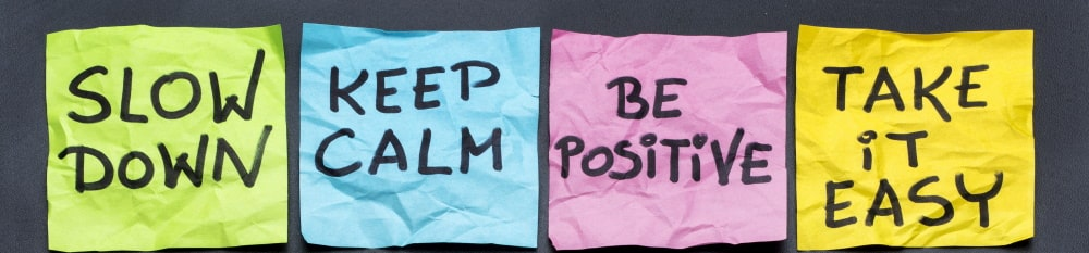 sticky notes: slow down, keep calm, be positive, and take it easy